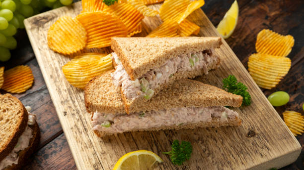 Healthy Tuna Sandwich with celery and onion on wooden board stock photo