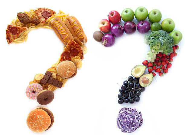 Healthy unhealthy food choices Unhealthy and healthy food ingredients in a the shape of question marks alongside each other unhealthy eating stock pictures, royalty-free photos & images