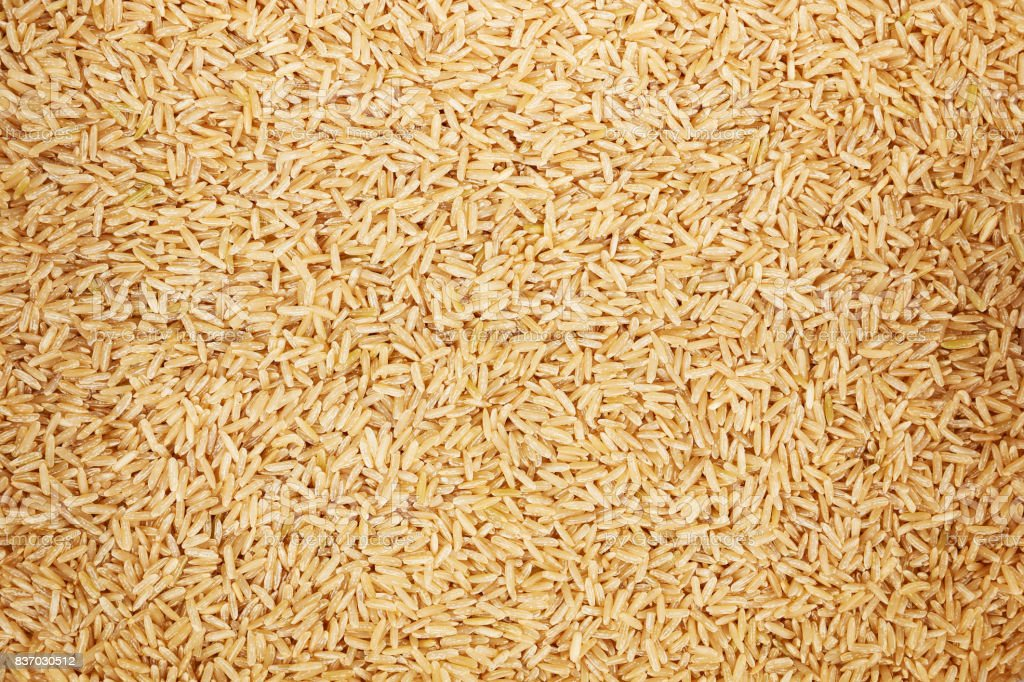 healthy unpolished brown rice for pattern and background stock photo