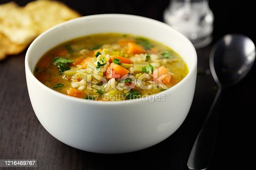 Home made freshness carrot,barley,celery,green lentils  broth with focaccia bread