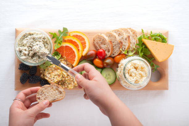POV, Healthy Vegan Cheese, Fruit and Vegetables on Recycled Board stock photo