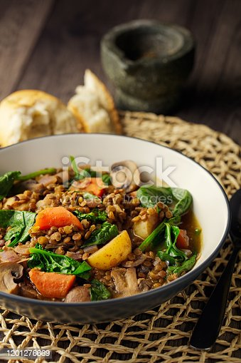 Home made freshness green lentil with baby potato,carrot,mushroom and spinach stew service with ciabatta bread for vegan