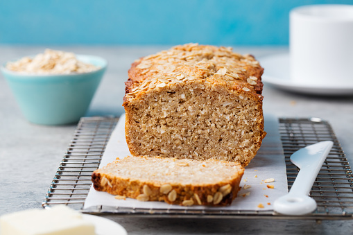 Healthy vegan oat, coconut loaf bread, cake on cooling rack