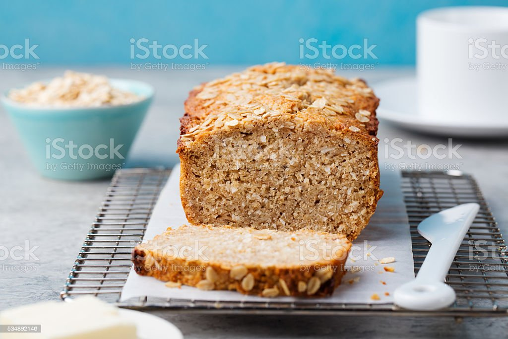Healthy vegan oat, coconut loaf bread, cake on cooling rack stock photo