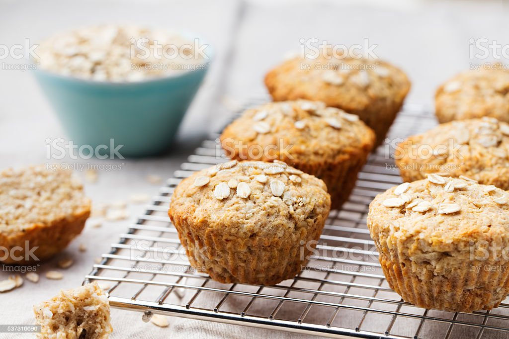 Healthy vegan oat muffins, apple, banana cakes on cooling rack stock photo