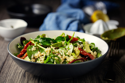 Home made freshness quinoa, spinach, avocado and sun dried tomatoes salad with pumpkin seeds and vinaigrette dressing