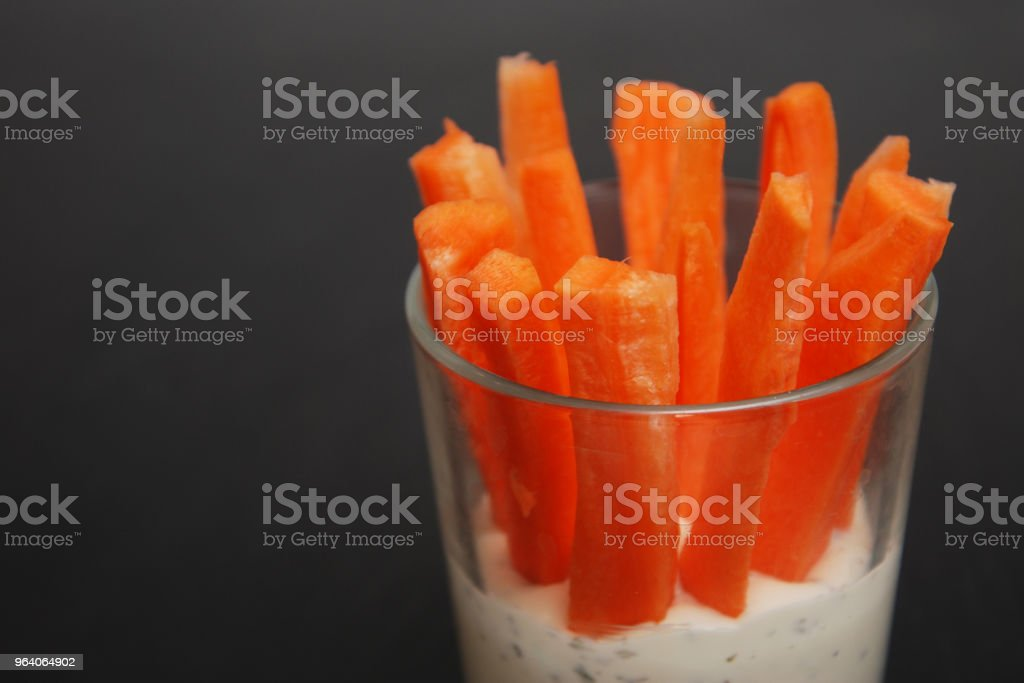 Healthy Vegan Snack: Slices of Carrots and Yogurt Sauce, Black Board, Copy space - Royalty-free Appetizer Stock Photo