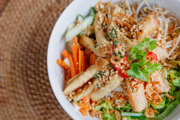 Healthy vegan Vietnamese noodle bowl Close up bun thit nuong - vegetarian vietnamese noodle bowl with lemongrass tofu rice noodles stock pictures, royalty-free photos & images