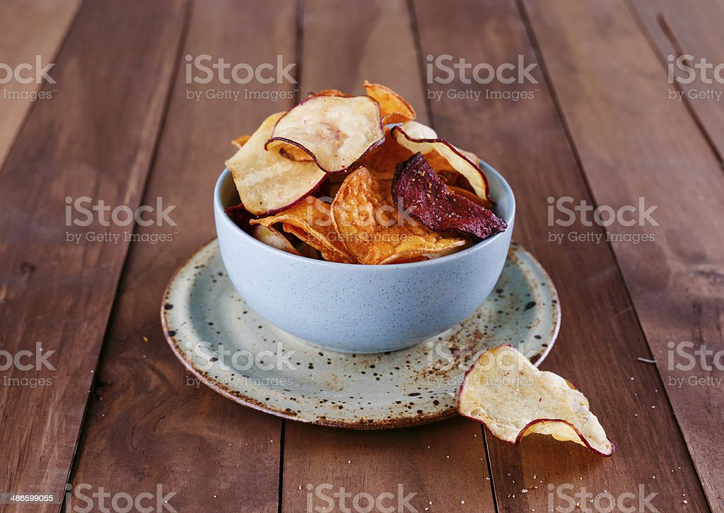 Healthy vegetable chips in a blue cup closeup royalty-free stock photo