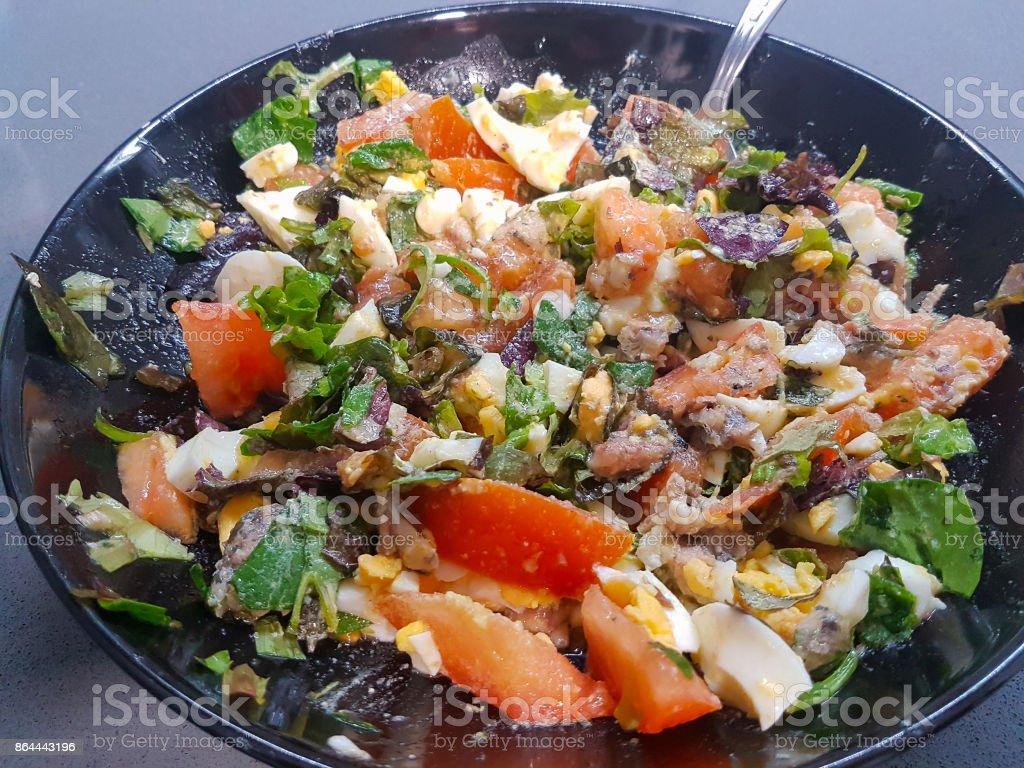 Healthy vegetable salad sardines and egg stock photo