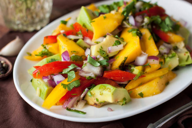 Healthy vegetable salad with mango, avocado stock photo