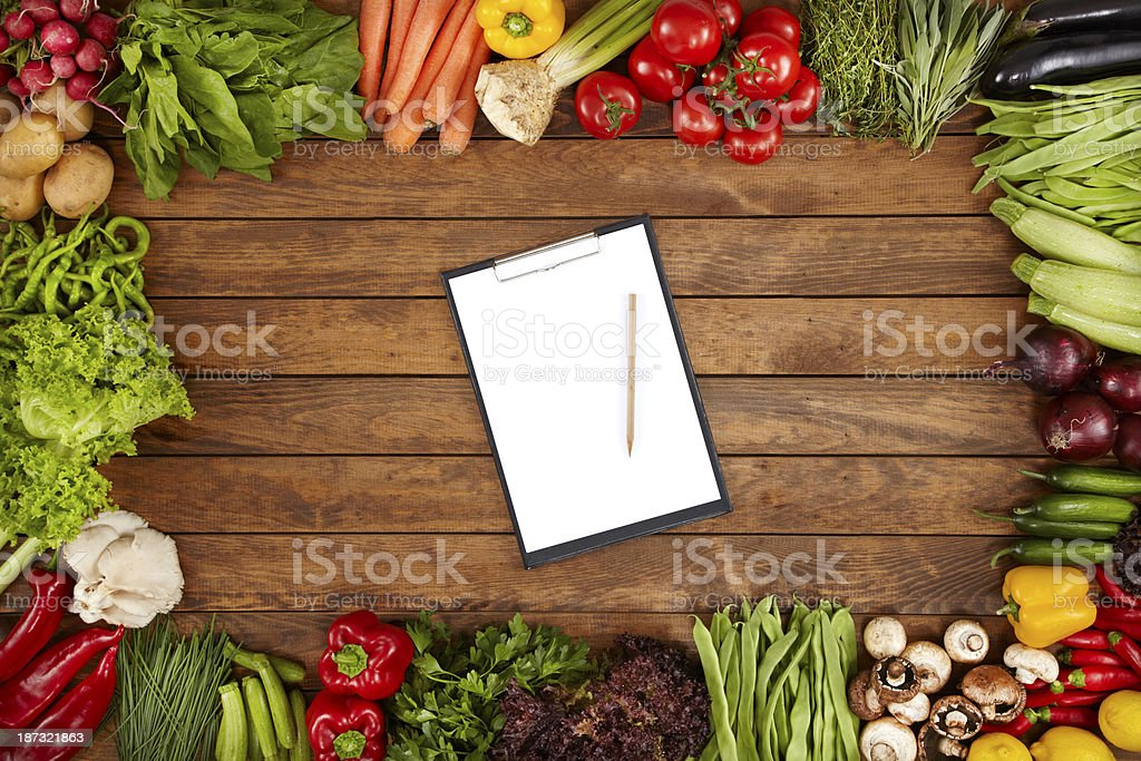 Healthy Vegetables And Blank Paper On A Wooden Background royalty-free stock photo