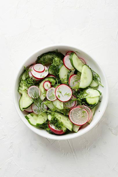 healthy vegetables salad in bowl - radieschen salat stock-fotos und bilder