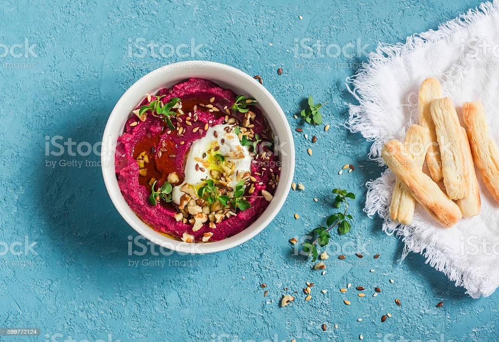Healthy vegetarian beet hummus and puff pastry bread sticks stock photo