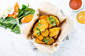 istock Healthy vegetarian nuggets with carrots, cauliflower and spinach. Vegetable nuggets. Vegan food. Top view, white background 1081766720
