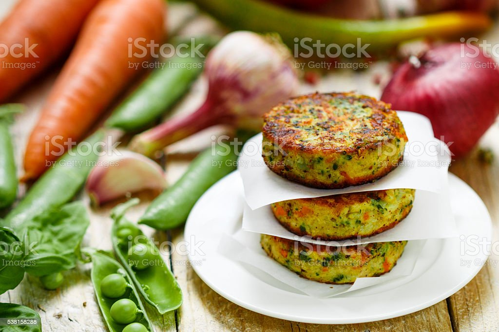 Healthy vegetarian patties made from potatoes, carrots, onions, green peas stock photo