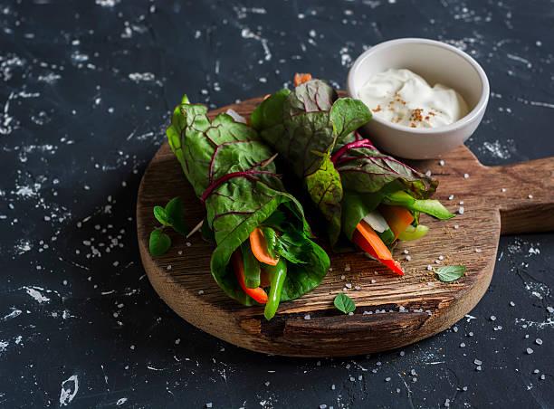 healthy vegetarian vegetables rolls and yoghurt sauce - mangoldgemüse stock-fotos und bilder