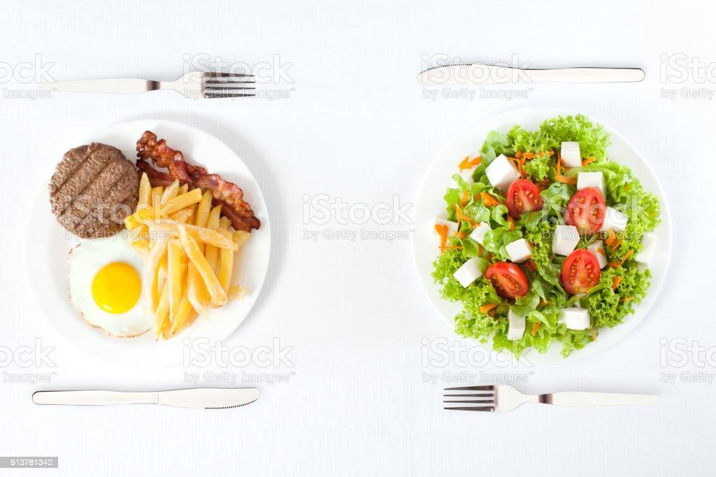 healthy versus junk food stock photo