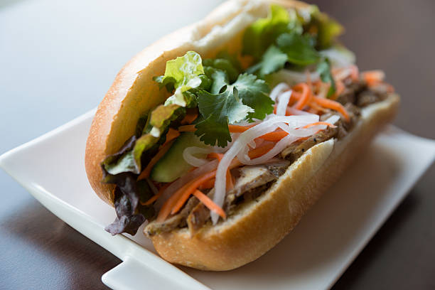 Healthy Vietnamese Chicken Sandwich A healthy Vietnamese lemongrass chicken sandwich. Banh mi filled with healthy vegetables. bánh mì sandwich stock pictures, royalty-free photos & images