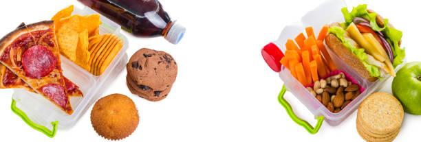 gesunde gegen ungesunde lunch-boxen - frucht pizza cookies stock-fotos und bilder
