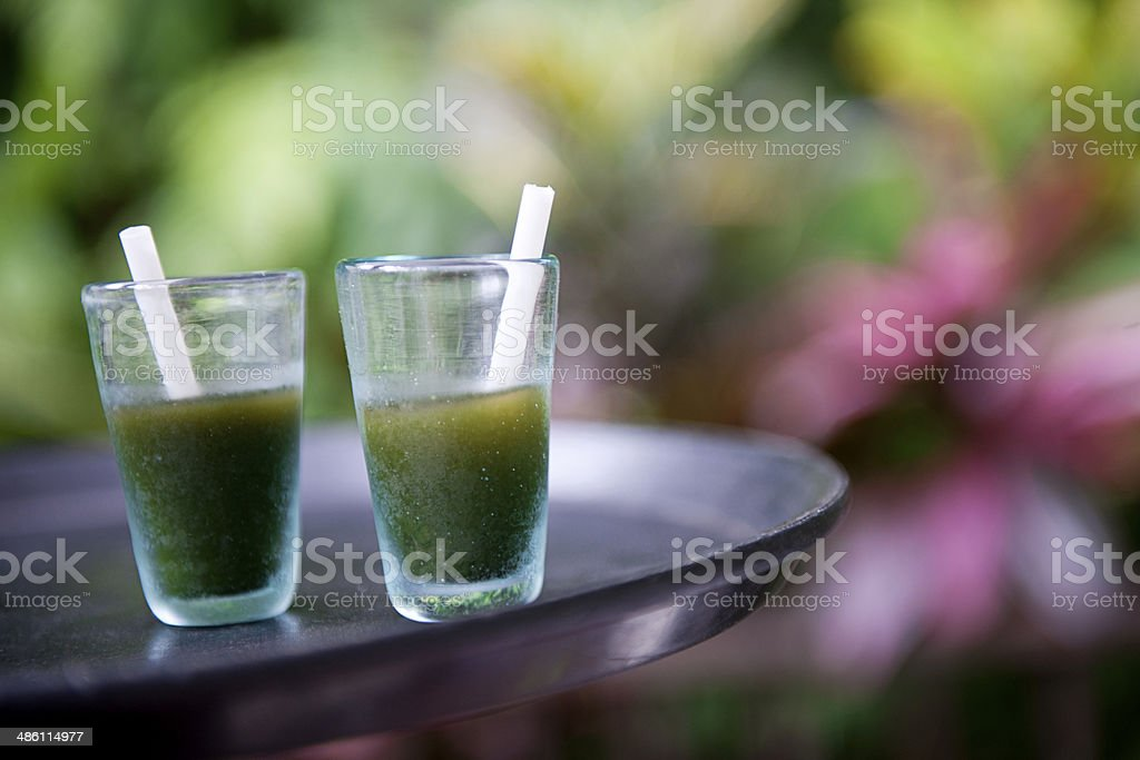 Healthy wheatgrass juice stock photo