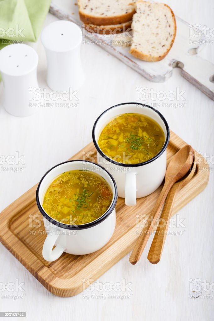 Healthy white bean soup with  mushroom in rustic white mugs stock photo