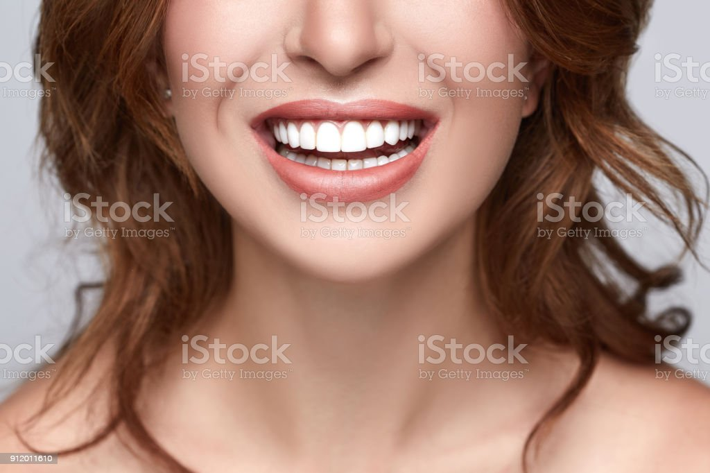 Healthy white smile close up. Beauty woman with perfect smile, lips and teeth. Beautiful Model Girl with white teeth and perfect skin. Teeth whitening. stock photo
