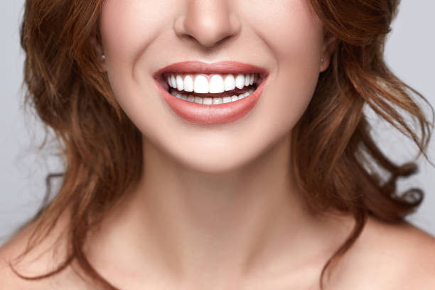 healthy white smile close up. beauty woman with perfect smile, lips and teeth. beautiful model girl with white teeth and perfect skin. teeth whitening. - teeth stock photos and pictures