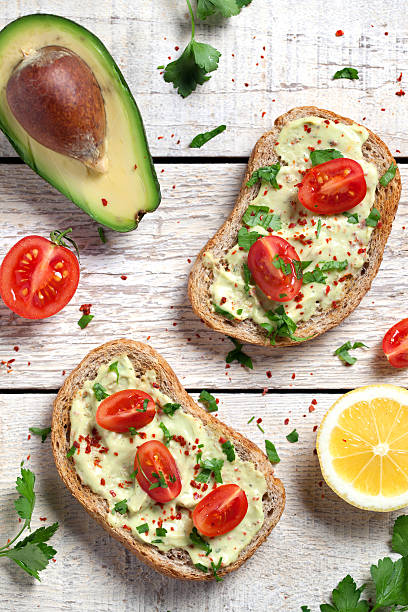 Healthy whole grain bread with avocado stock photo