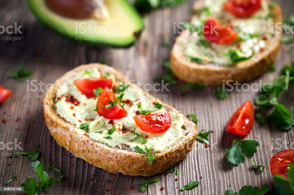 Healthy whole grain bread with avocado stock photo