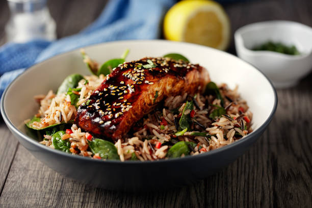 healthy wild rice salad with grilled teriyaki  salmon fillet - crockery stock photos and pictures