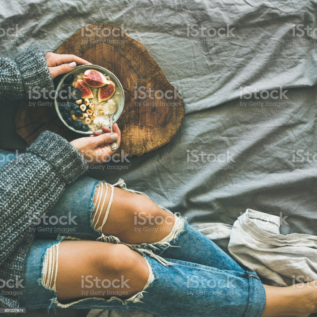 Healthy winter breakfast in bed concept, top view, square crop stock photo