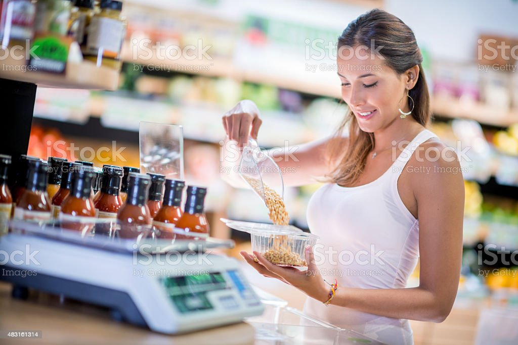 Healthy woman buying cereals at the market stock photo
