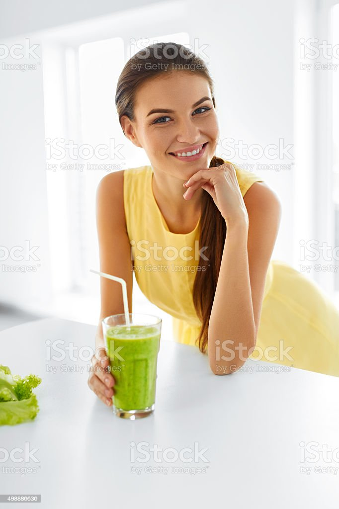 Healthy Woman. Portrait Of Beautiful Smiling Girl Drinking Green...