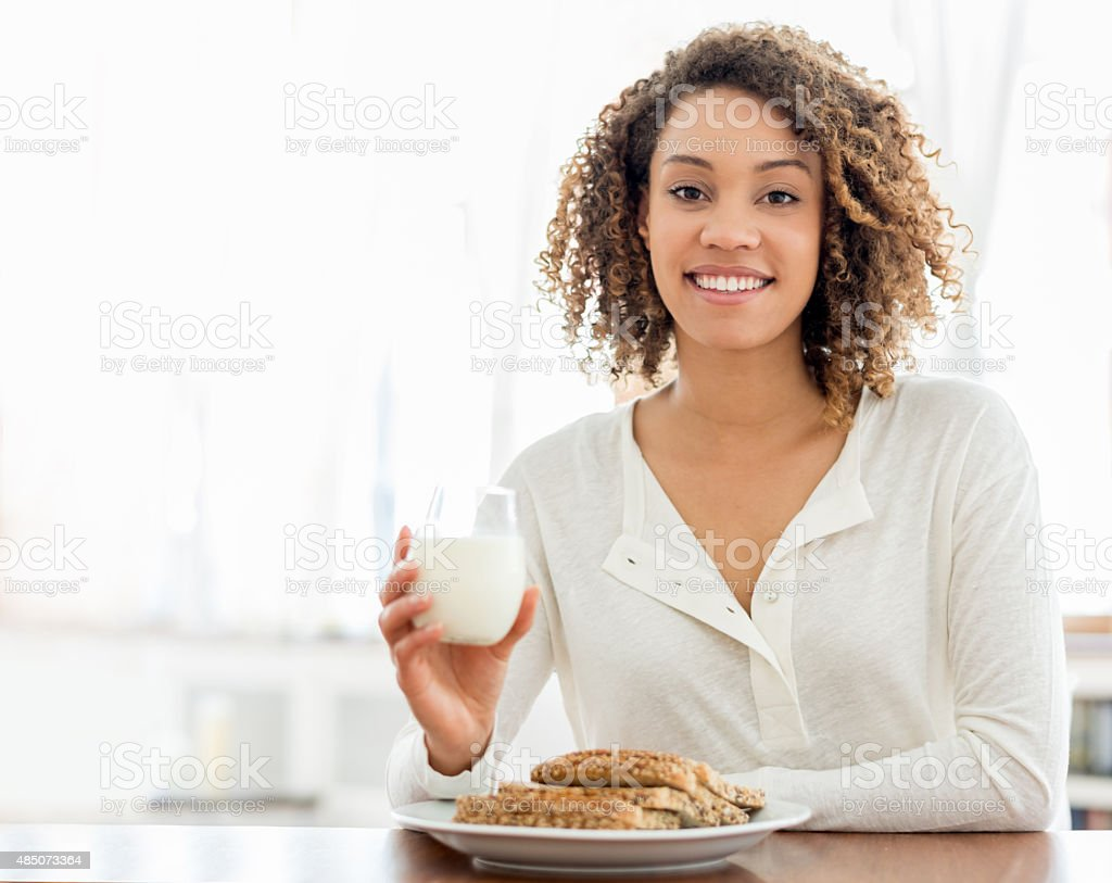 Healthy woman eating breakfast stock photo