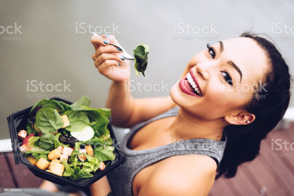 healthy woman eating the salad stock photo