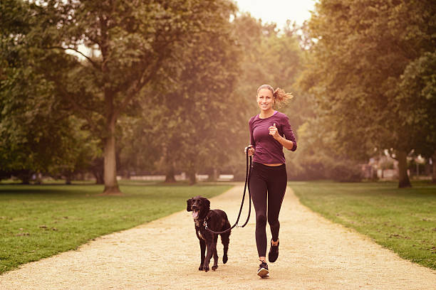 Healthy woman jogging in the park with her dog picture id488515352?b=1&k=6&m=488515352&s=612x612&w=0&h=glazfxlhpjhm2q988 lp63fw8ua6aaht20r 5xfwjxu=