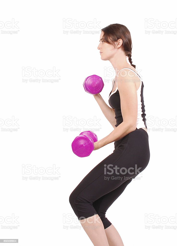Healthy woman lifting weights royalty free stockfoto