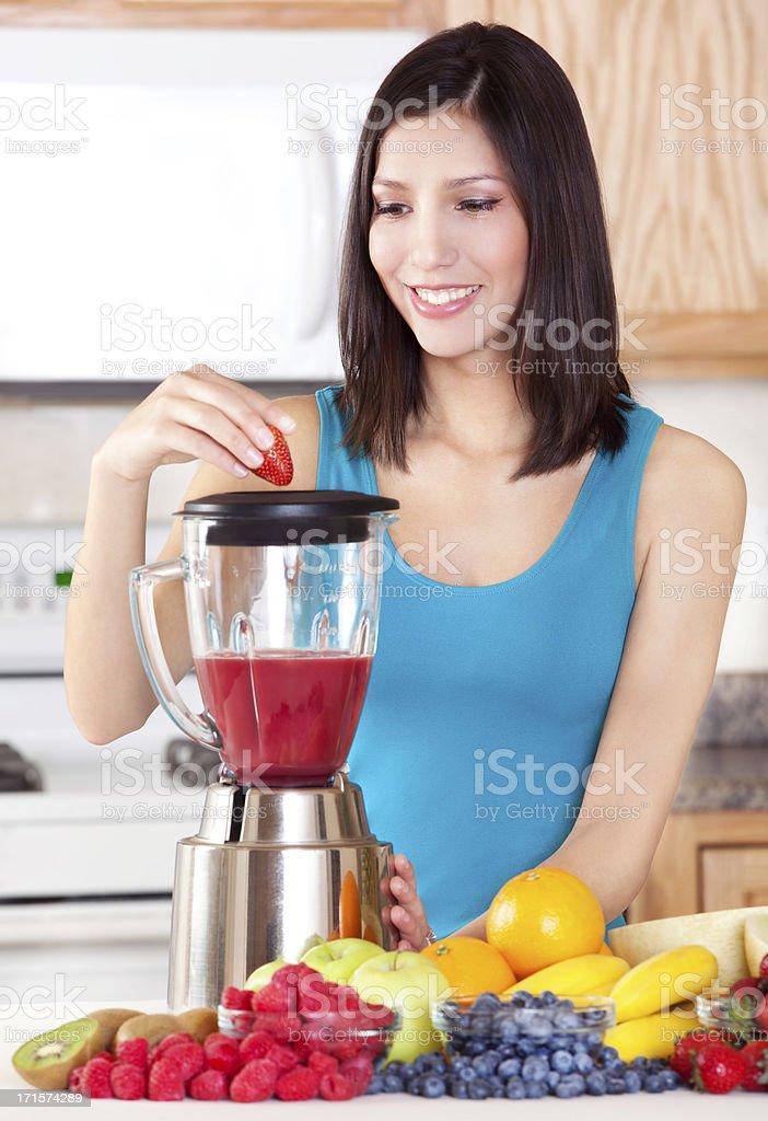 Healthy Woman Making Fresh Fruit Smoothie royalty-free stock photo