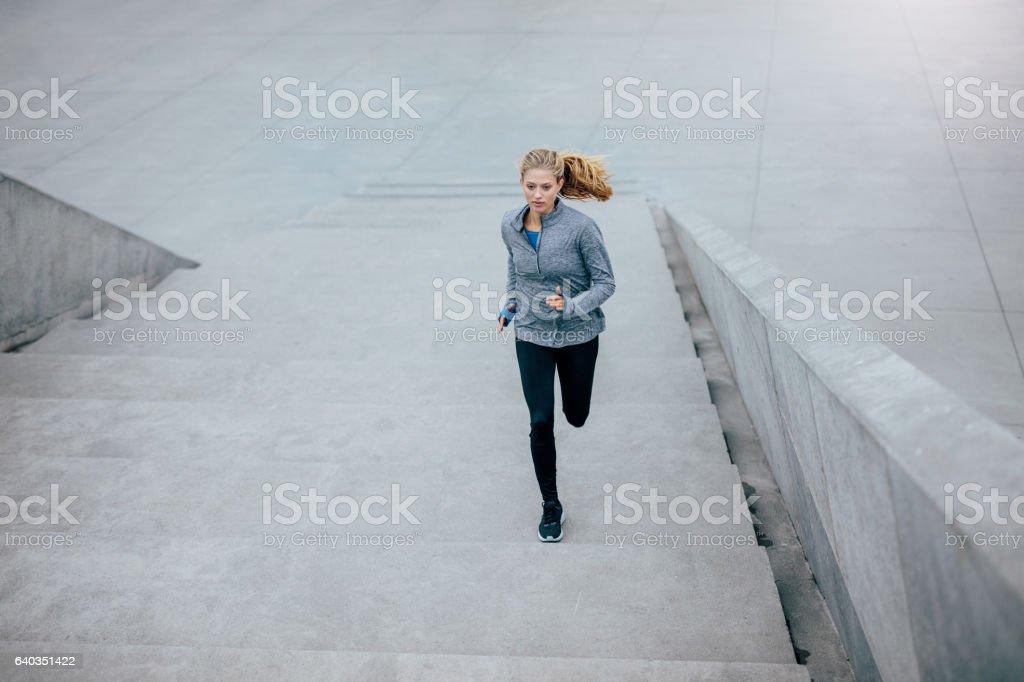 Healthy woman on morning run stock photo