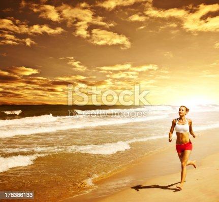 638688656 istock photo Healthy woman running on the beach 178386133