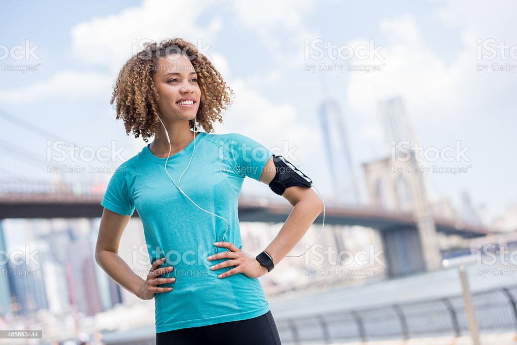Healthy woman running outdoors stock photo
