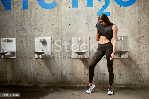 Healthy Woman Taking Rest After Training Session Stock Photo & More Pictures of Adult