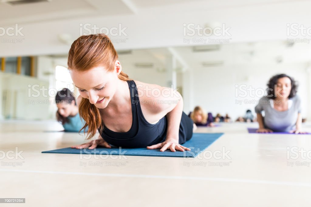Healthy women exercising together in yoga class. stock photo