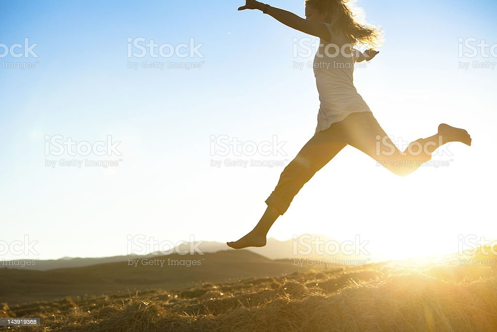 Healthy young beautiful woman running barefoot stock photo