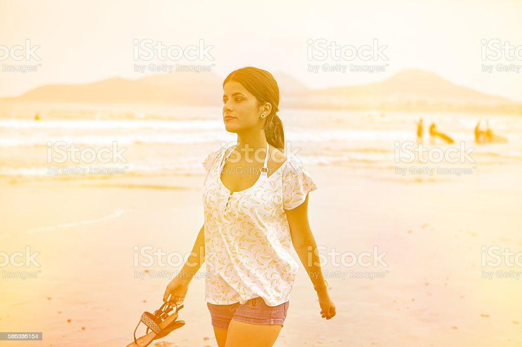 Healthy young brunette girl on the beach stock photo