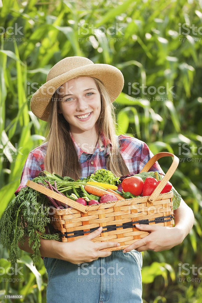 Healthy Young Farmer Girl Holding Basket of Fresh Produce Vt royalty-free stock photo