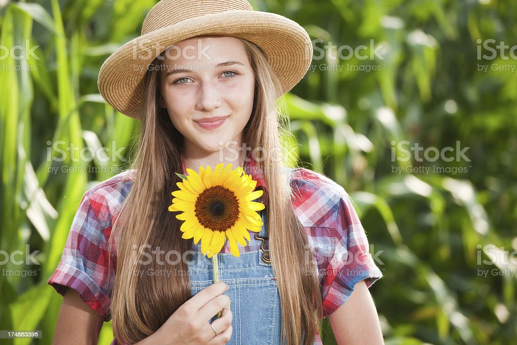 Healthy Young Farmer Girl Holding Sunflower by the Field Hz royalty-free stock photo