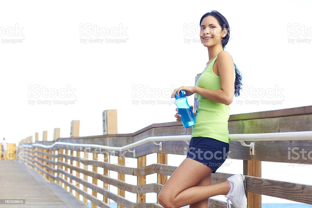 Healthy Young Fitness Woman Holding Waterbottle royalty-free stock photo