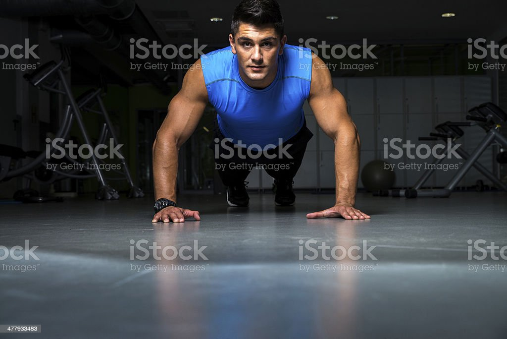 Healthy young guy doing push up exercise royalty-free stock photo